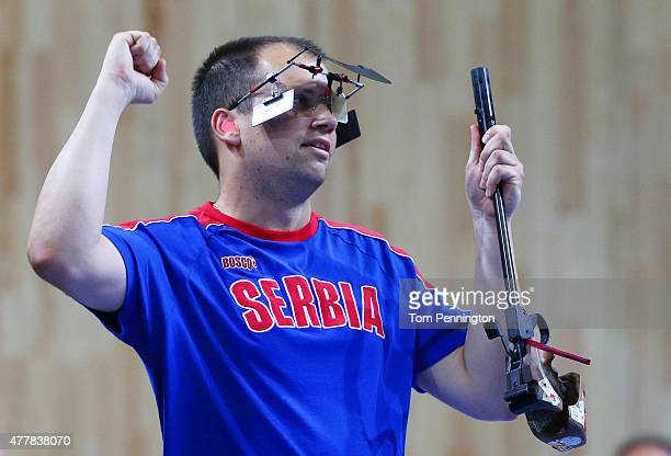 Gold medalist Damir Mikec of Serbia celebrates victory during the Men's Pistol Shooting 50m final on day eight of the Baku 2015 European Games at the...