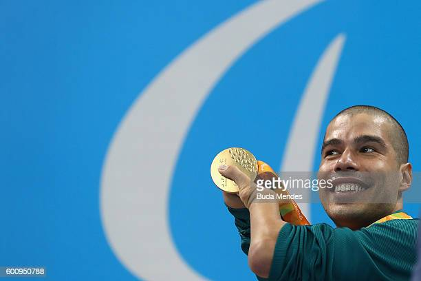Gold medalist Daniel Dias of Brazil celebrates on the podium at the medal ceremony for the Men's 200m Freestyle S5 Final on day 1 of the Rio 2016...