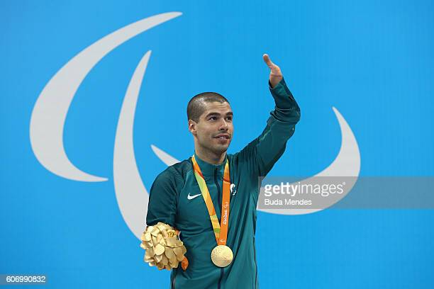 Gold medalist Daniel Dias of Brazil celebrates on the podium at the medal ceremony for the Men's 50m Backstroke S5 on day 9 of the Rio 2016...