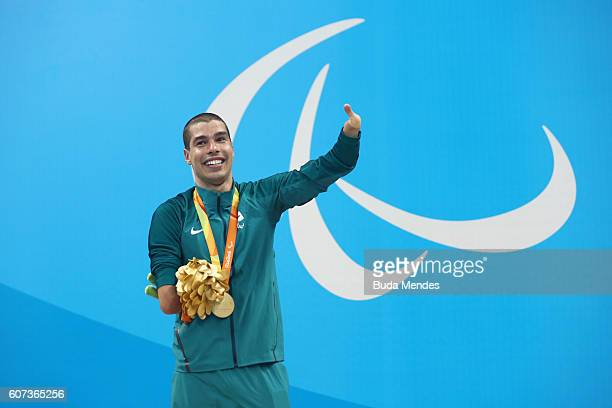 Gold medalist Daniel Dias of Brazil celebrates on the podium at the medal ceremony for the Men's 100m Freestyle S5 on day 10 of the Rio 2016...