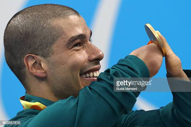 Gold medalist Daniel Dias of Brazil poses on the podium at the medal ceremony for the Mens 50m Freestyle S5 Final during day 5 of the Rio 2016...