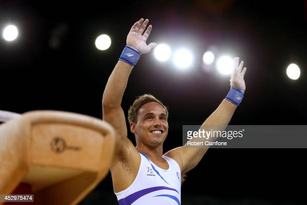 Gold medalist Daniel Keatings of Scotland celebrates after competing in the medal ceremony for the Men's Pommel Horse Final at SSE Hydro during day...