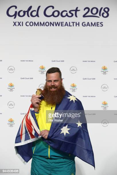 Gold medalist Daniel Repacholi of Australia poses during the medal ceremony for the Men's 50m Pistol Finals on day seven of the Gold Coast 2018...
