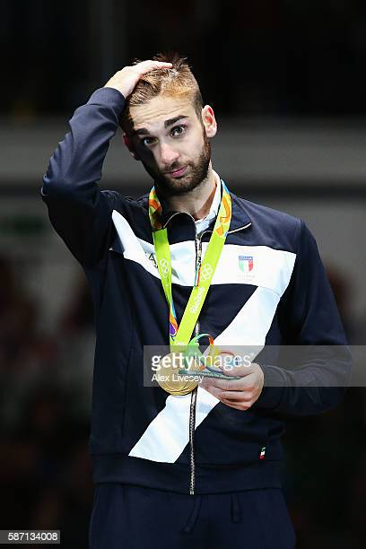 Gold medalist Daniele Garozzo of Italy celebrates on the podium during the medal ceremony for the Men's Individual Foil Final on Day 2 of the Rio...