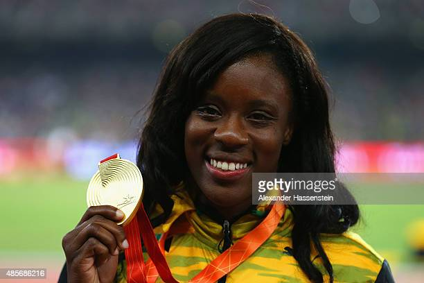 Gold medalist Danielle Williams of Jamaica poses on the podium during the medal ceremony for the Women's 100 metres final during day eight of the...