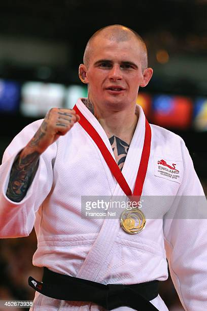Gold medalist Danny Williams of England celebrates during the medal ceremony for the Men's 73kg Judo at SECC Precinct during day two of the Glasgow...