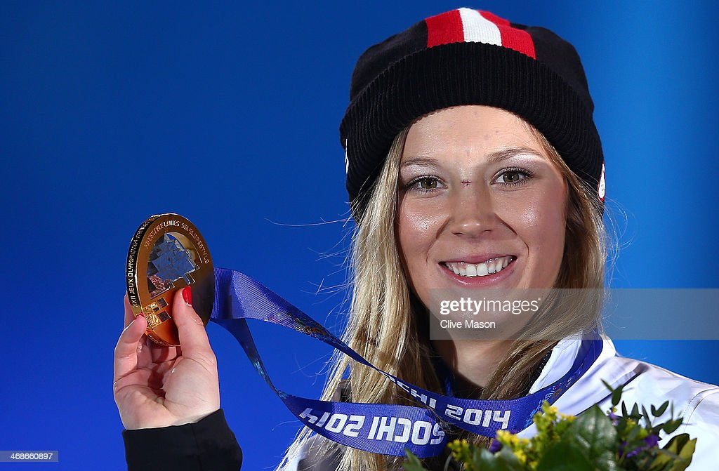 Gold medalist Dara Howell of Canada celebrates during the medal ceremony for the Freestyle Skiing Women's Ski Slopestyle on day 4 of the Sochi 2014 Winter Olympics at Medals Plaza on February 11, 2014 in Sochi, Russia.