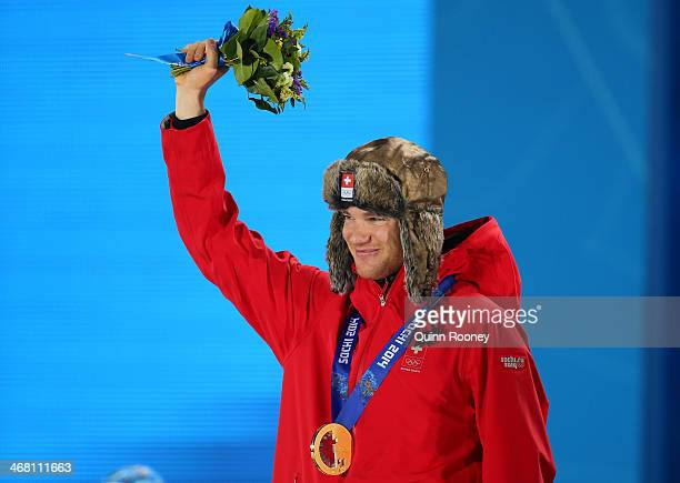 Gold medalist Dario Cologna of Switzerland celebrates during the medal ceremony for the Men's Skiathlon 15 km Classic 15 km Free on day 2 of the...