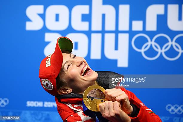 Gold medalist Darya Domracheva of Belarus celebrates during the medal ceremony for the Biathlon Women's 15km Individual on day 8 of the Sochi 2014...