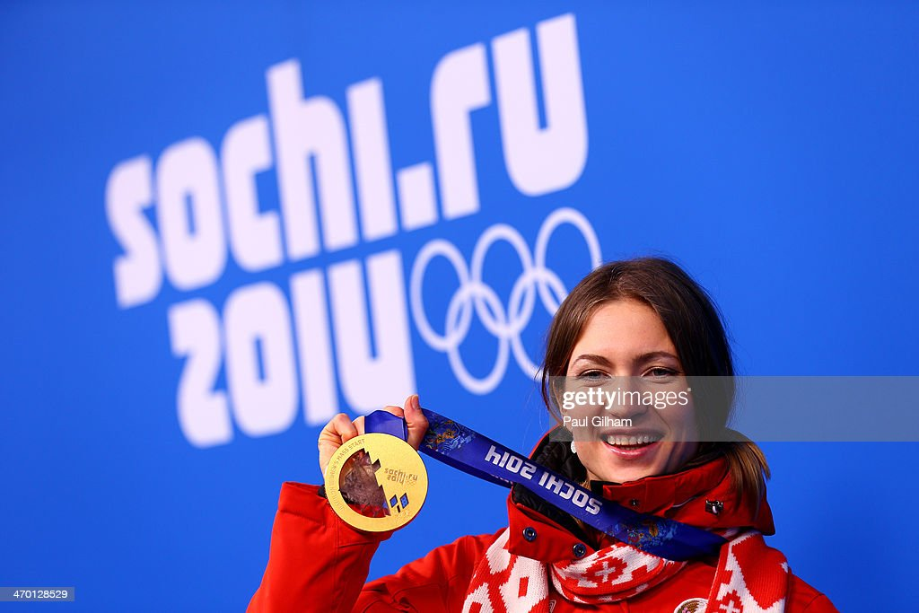 Gold medalist Darya Domracheva of Belarus celebrates during the medal ceremony for the Women's 12.5 km Mass Start on day 11 of the Sochi 2014 Winter Olympics at Medals Plaza on February 18, 2014 in Sochi, Russia.