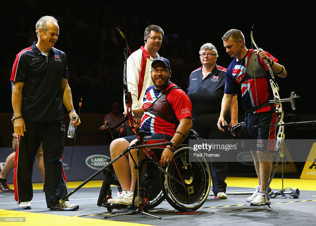 Gold medalist David Hubber (C) of Great Britain smiles as silver medalist Gary Prout (R) of Great Britain looks on after the Mixed Individual Recurve Open Archery final during day 2 of the Invictus Games, presented by Jaguar Land Rover at Here East on September 12, 2014 in London, England.