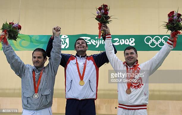 Gold medalist David Kostelecky of the Czech Republic silver medalist Giovanni Pelliolo of Italy and broze medalist Alipov Alexey of Russia celebrate...