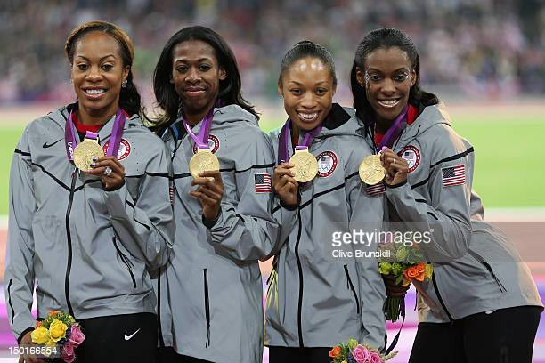 Gold medalist DeeDee Trotter Allyson Felix Francena McCorory and Sanya RichardsRoss of the United States pose on the podium during the medal ceremony...