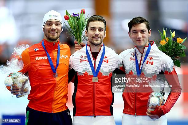 Gold medalist Denny Morrison of Canada Silver medalist Kjeld Nuis of the Netherlands and Bronze medalist Vincent De Haitre of Canada pose for a photo...