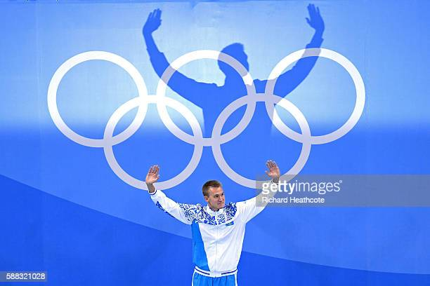 Gold medalist Dmitriy Balandin of Kazakhstan celebrates on the podium during the medal ceremony for the Men's 200m Breaststroke Final on Day 5 of the...
