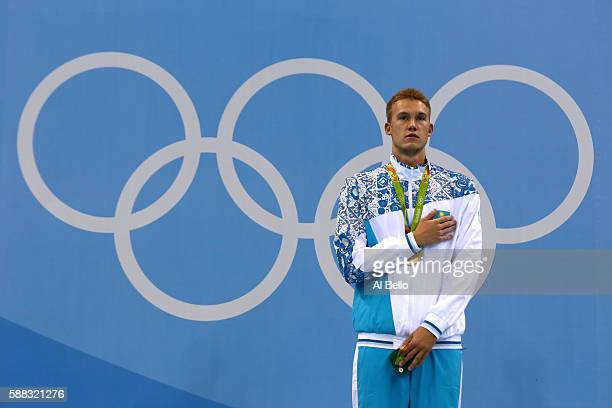 Gold medalist Dmitriy Balandin of Kazakhstan poses on the podium during the medal ceremony for the Men's 200m Breaststroke Final on Day 5 of the Rio...
