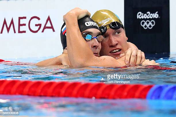 Gold medalist Dmitriy Balandin of Kazakhstan reacts with bronze medalist Anton Chupkov of Russia after competing in the Men's 200m Breaststroke Final...