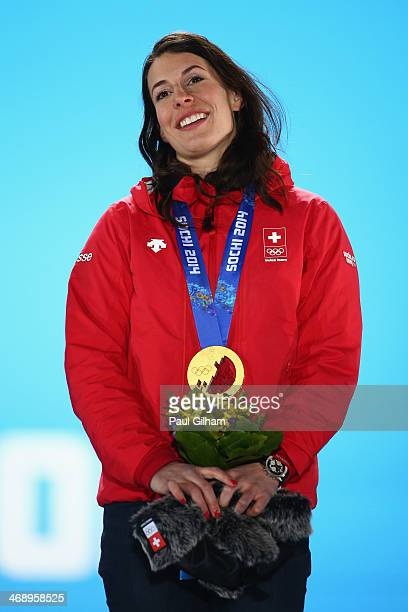 Gold medalist Dominique Gisin of Switzerland celebrates during the medal ceremony for the Alpine Skiing Women's Downhill on day five of the Sochi...