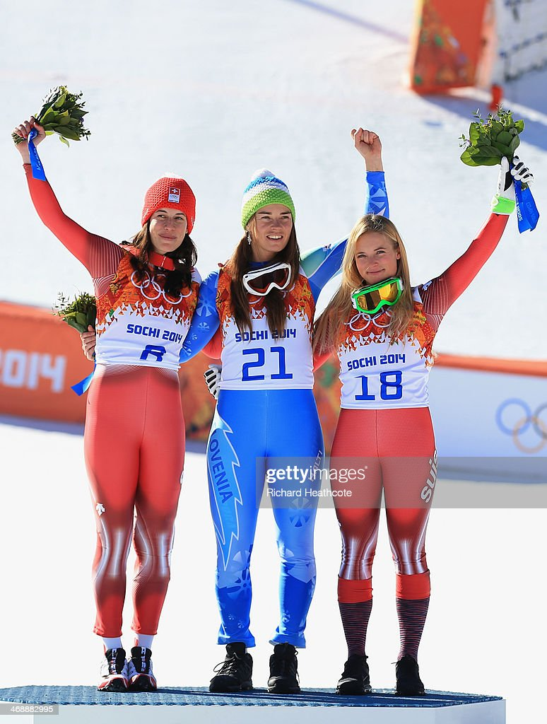 Gold medalist Dominique Gisin of Switzerland, gold medalist Tina Maze of Slovenia and bronze medalist Lara Gut of Switzerland celebrate on the podium during the flower ceremony for during the Alpine Skiing Women's Downhill on day 5 of the Sochi 2014 Winter Olympics at Rosa Khutor Alpine Center on February 12, 2014 in Sochi, Russia.