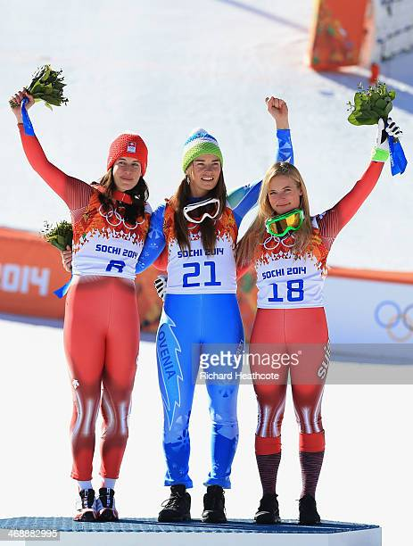 Gold medalist Dominique Gisin of Switzerland gold medalist Tina Maze of Slovenia and bronze medalist Lara Gut of Switzerland celebrate on the podium...