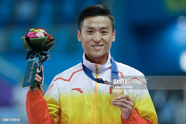 Gold medalist Dong Dong of China celebrates during the medal ceremony after the Gymnastics Trampoline Men's Final in day seven of the 2014 Asian...