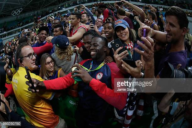 Gold medalist Draymond Green of the United States celebrates with the crowd after defeating Serbia in the Men's Gold medal game on Day 16 of the Rio...