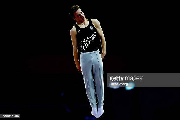 Gold medalist Dylan Schmidt of New Zealand competes in the Men's Trampoline Gymnastic Final of Nanjing 2014 Summer Youth Olympic Games at Olympic...