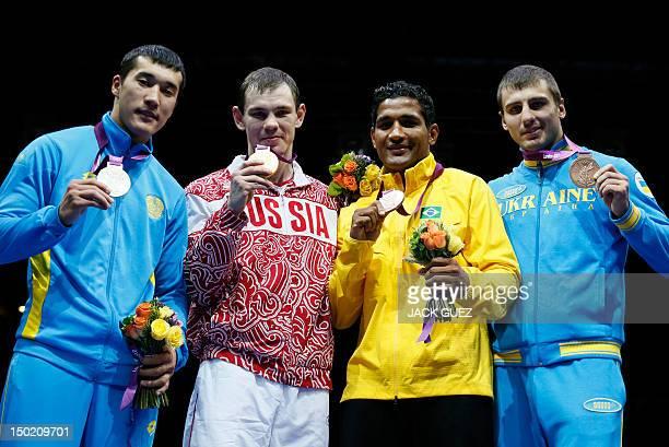 Gold medalist Egor Mekhontcev of Russia stands with silver medalist Adilbek Niyazymbetov of Kazakhstan bronze medalists Yamaguchi Falcao Florentino...