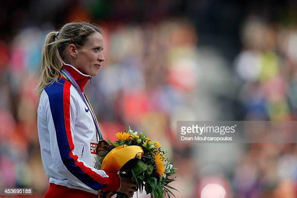 Gold medalist Eilidh Child of Great Britain and Northern Ireland stands on the podium during the medal ceremony for the Women's 400 metres hurdles...