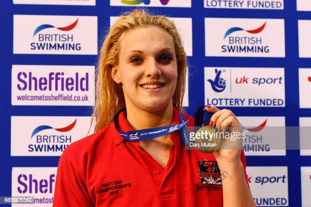 Gold medalist Eleanor Faulkner of Co Sheffield poses with the medal won in the Womens Open 200m Freestyle final on day one of the British Swimming...