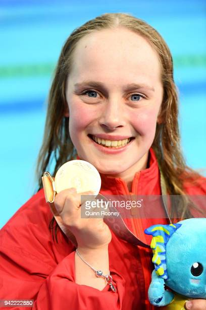 Gold medalist Eleanor Robinson of England poses during the medal ceremony for the Women's S7 50m Butterfly Final on day one of the Gold Coast 2018...