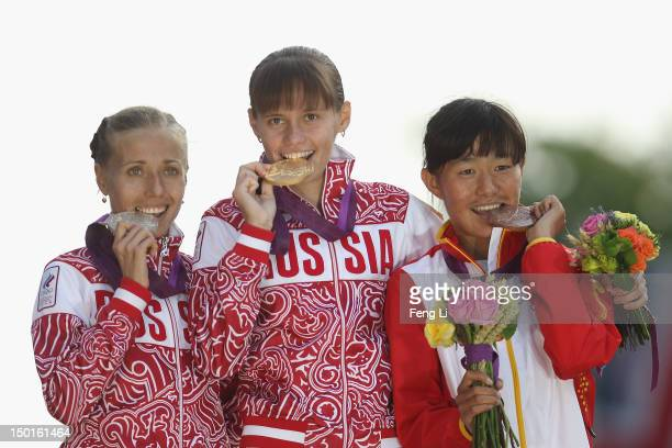 Gold medalist Elena Lashmanova of Russia silver medalist Olga Kaniskina of Russia and bronze medalist Shenjie Qieyang of China attend the medal...
