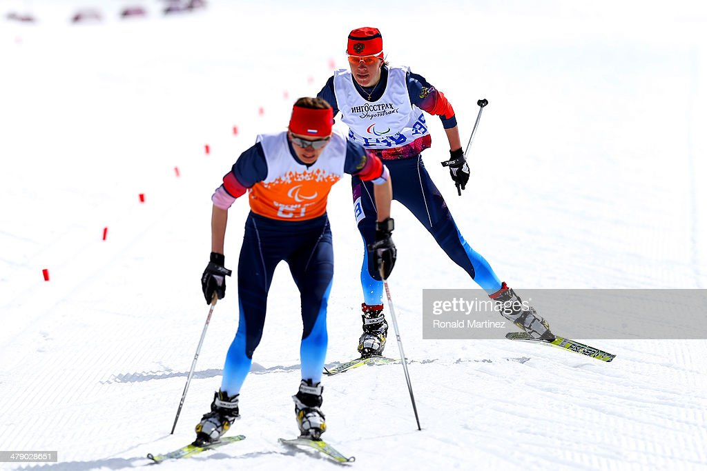Gold medalist Elena Remizova of Russia and guide Natalia Yakimova drive towards the finish line in the Women's Cross Country 5km Free – Visually Impaired on day nine of the Sochi 2014 Paralympic Winter Games at Laura Cross-country Ski and Biathlon Center on March 16, 2014 in Sochi, Russia.