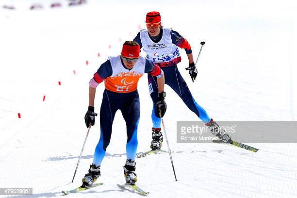Gold medalist Elena Remizova of Russia and guide Natalia Yakimova drive towards the finish line in the Women's Cross Country 5km Free – Visually...