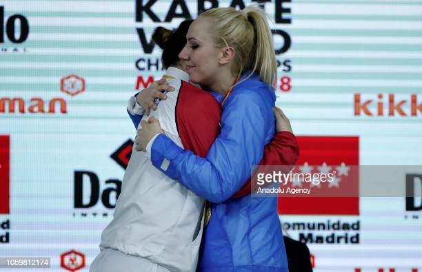 Gold medalist Eleni Chatziliadou of Greece hugsn silver medalist Ayumi Uekusa of Japan at the end of the Women's 68kg Kumite competitions within the...