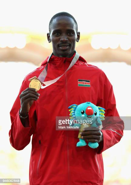 Gold medalist Elijah Motonei Manangoi of Kenya celebrates during the medal ceremony for the Men's 1500 metresduring athletics on day 10 of the Gold...
