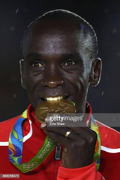 Gold medalist Eliud Kipchoge of Kenya celebrates during the medal ceremony for the Men's Marathon during the Closing Ceremony on Day 16 of the Rio...
