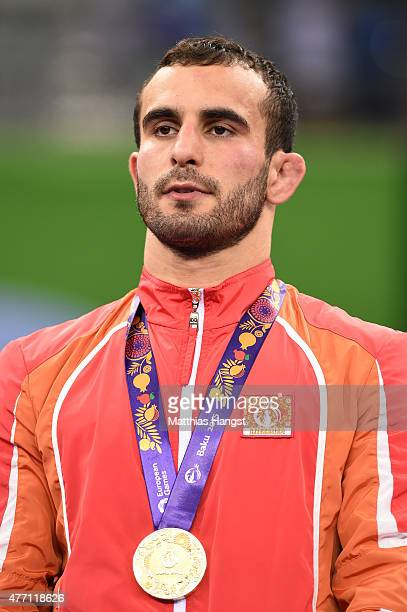 Gold Medalist Elvin Mursaliyev of Azerbaijan poses with his medal won in the Men's Wrestling 75kg Greco Roman finals during day two of the Baku 2015...