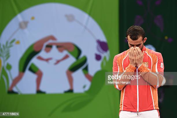 Gold Medalist Elvin Mursaliyev of Azerbaijan reacts prior to receiving his medal won in the Men's Wrestling 75kg Greco Roman finals during day two of...