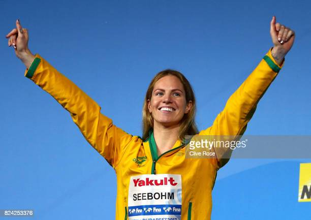 Gold medalist Emily Seebohm of Australia celebrates during the medal ceremony for the Women's 200m Backstroke final on day sixteen of the Budapest...