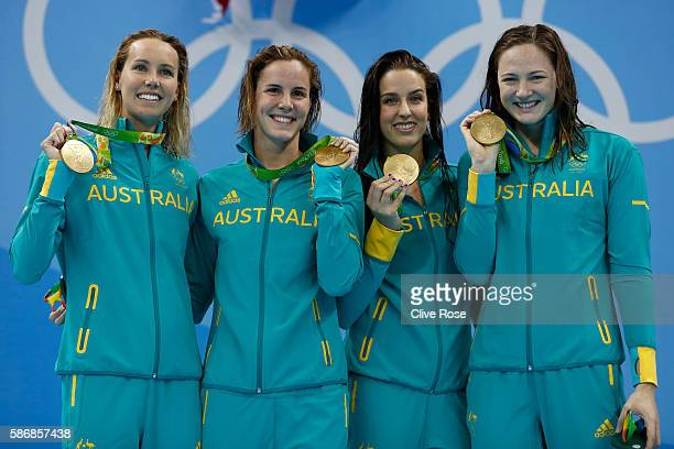 Gold medalist Emma McKeon, Brittany Elmslie, Bronte Campbell and Cate Campbell of Australia pose during the medal ceremony for the Final of the...