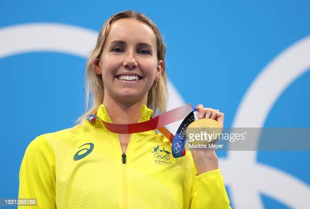 Gold medalist Emma McKeon of Team Australia celebrates on the podium during the medal ceremony for the Women's 100m Freestyle Final on day seven of...