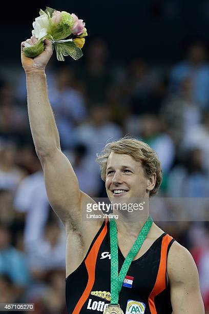 Gold medalist Epke Zonderland of the Netherlands celebrates during the medal ceremony after Men's Horizontal Bar Final on day six of the 45th...