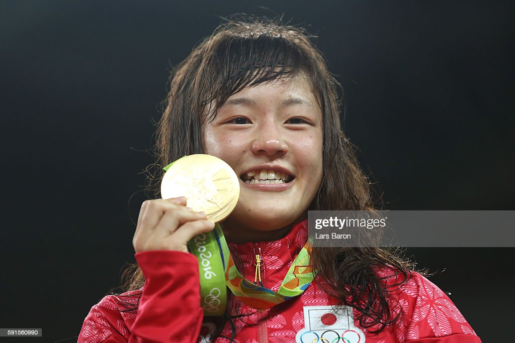 Gold medalist Eri Tosaka of Japan celebrates on the podium during the medal cermony for the Women's Freestyle 48kg event on Day 12 of the Rio 2016 Olympic Games at Caioca Arena 2 on August 17, 2016 in Rio de Janeiro, Brazil.
