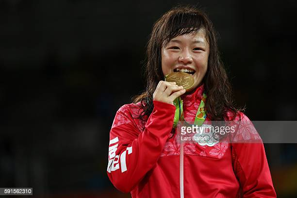Gold medalist Eri Tosaka of Japan celebrates on the podium during the medal cermony for the Women's Freestyle 48kg event on Day 12 of the Rio 2016...