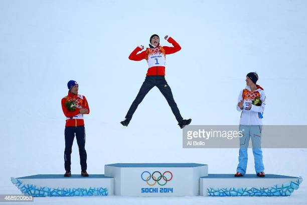 Gold medalist Eric Frenzel of Germany jumps in celebration alongside silver medalist Akito Watabe of Japan and bronze medalist Magnus Krog of Norway...