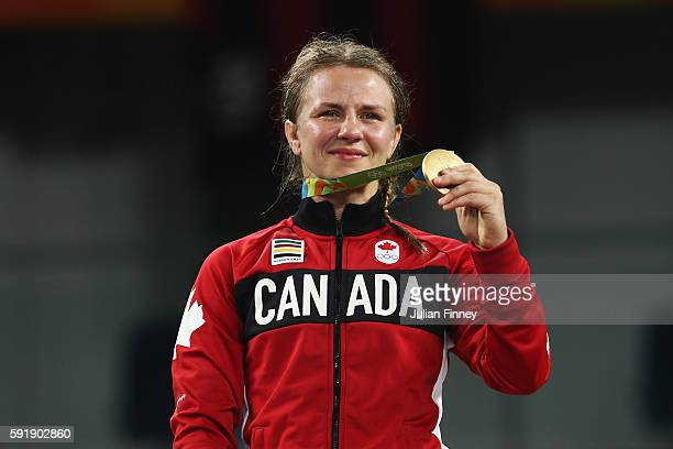 Gold medalist Erica Elizabeth Wiebe of Canada celebrates during the medal ceremony following the Women's Freestyle 75 kg competition on Day 13 of the...