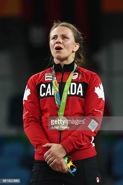 Gold medalist Erica Elizabeth Wiebe of Canada sings along to the national anthem during the medal ceremony following the Women's Freestyle 75 kg...