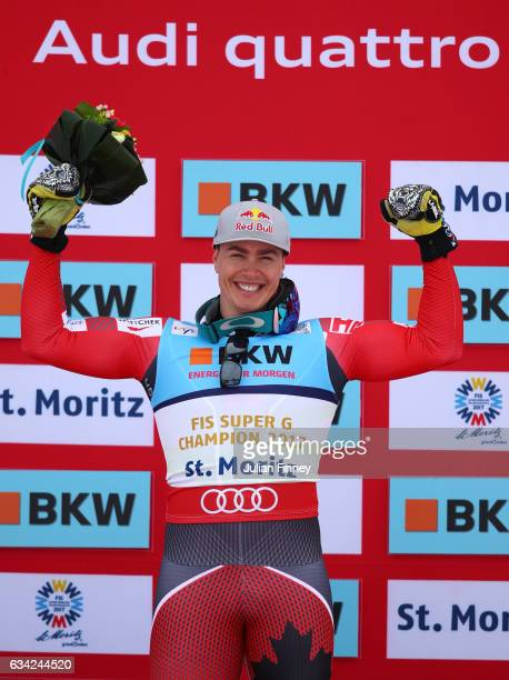 Gold medalist Erik Guay of Canada celebrates during the flower ceremony for the Men's Super G during the FIS Alpine World Ski Championships on...