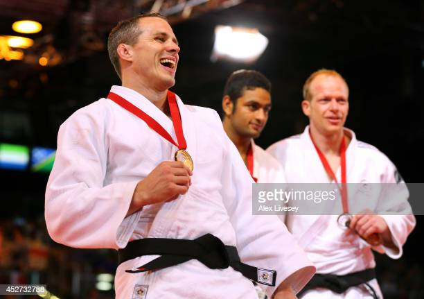 Gold medalist Euan Burton of Scotland on the podium during the medal ceremony for the Men's 100kg Judo final at the Scottish Exhibition and...